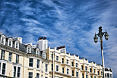 Architectural detail of buildings against a blue sky on Kings Road, Brighton Beach, Brighton, East Sussex, UK.