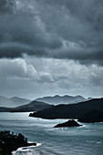 Looking through to the north side of Catseye Beach during a rain storm, Hamilton Island, Whitsunday Islands, Queensland, Australia.
