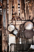 Vintage farm paraphernalia hangs on the wall of an old barn on a property in Mummel, New South Wales, Australia.