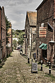 A cobblestone laneway with old buildings in Rye, East Sussex, UK.