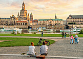 Young people enjoy the sunset in front of the Dresden skyline, Saxony, Germany