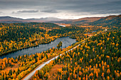 VW bus on lonely road by the lake through autumn forest in northern Sweden, Wilderness Road, from above