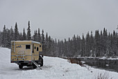Ford Ranger with add-on cabin in deep snow on a river, Storjola, Lapland, Sweden