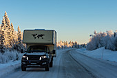 Ford Ranger with add-on cabin on an icy road in deep winter, near Lycksele, Lapland, Sweden