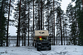 A van is parked in a parking space by the river in deep winter, Östavall, Lapland, Sweden