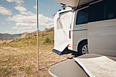 VW bus with awning, VW T6 California, Bulli, map on table, Liguria, Italy