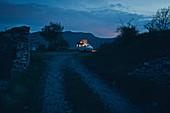 VW bus illuminated in the blue hour, VW T6 California, Bulli, mountains at dusk, blue hour, Liguria, Italy