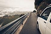 VW bus on mountain road, VW T6 California, Bulli, Liguria, Italy
