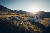 VW bus and sunrise in the mountains, Ligurian Alps, VW T6 California, Bulli, Liguria, Italy
