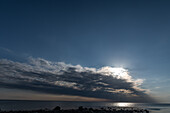 Sun and clouds over the sea at Grimsholmen, Halland, Sweden