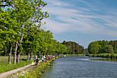 Numerous anglers sit on the Göta Canal, near Norrqvarn, Västra Götaland, Sweden