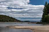 A small bay with a beach on a summer day by the sea, near Avikebruk, Västernorrland, Sweden