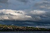 Dark clouds over the houses on the banks of Lake Siljan, Rättvik, Dalarna, Sweden
