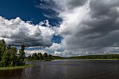 Rain showers and dark clouds over a lake at Bramabo, Dalarna, Sweden