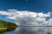 Rain front and dramatic clouds over Lake Siljan near Sollerön, Dalarna, Sweden