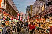 Street scene in the Ueno Ameya-Yokocho district at sunset, Tokyo, Japan