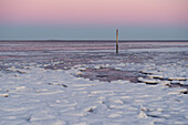 Ice floes on the beach at dusk with a view of Mellum Island, Schillig, Wangerland, Friesland, Lower Saxony, Germany, Europe