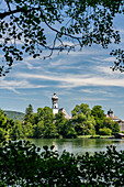 View in sunshine over the Höglwörther See to the monastery, Chiemgau, Bavaria, Germany