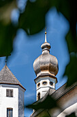 Looking up to the church tower from Höglwörth Monastery, Chiemgau, Bavaria, Germany
