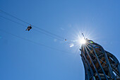 People are roped down from the Pyramidenkogel viewing tower, Carinthia, Austria