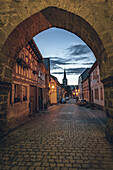 View through the Geiersberg city gate of the medieval town of Seßlach in the Upper Franconian district of Coburg