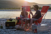 Albania, Southern Europe, young couple camping at sunset