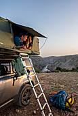 Croatia, Zrmanja, Winnetou, couple in the roof tent on an off-road vehicle