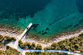 Road trip Croatia, with the camper on a jetty on the coast, aerial view from above