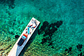 Road trip Croatia, two people with leisure equipment, bicycles, SUP board and camper on a jetty