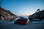 Road trip Croatia, in the evening with the camper on the coast