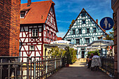 The leaning house and restaurant Acropolis in Forchheim, Bavaria, Germany