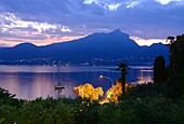 Evening view in Torri del Benaco to the west bank at Salo, east bank, Lake Garda, Veneto, Italy