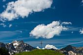 Cross at the Willersalpe, Hintersteiner Tal, behind the mountain Großer Thumb, 2280m, Bad Hindelang, Allgäu, Bavaria, Germany, Europe