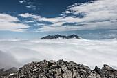 The Watzmann rises from the sea of fog, Berchtesgaden Alps, Bavaria, Germany