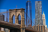 The Brooklyn Bridge connects Manhattan and Brooklyn with a view of the One World Trade Center