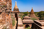 Individual stupas decorate a building of the historical temple complex of Bagan in Myanmar