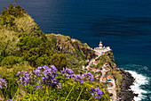 The picturesque harbor and lighthouse by the sea on the Portuguese island of São Miguel