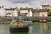 Lifebuoy, fishing boat, low tide, historic harbor, fishing village of Portsoy, near Banff, Aberdeenshire, Scotland, UK