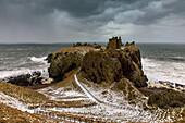 Gloomy black clouds over Dunnottar Castle in winter, storm, North Sea, ruin, Aberdeenshire, Scotland, UK