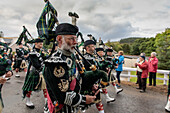 Men of Lonach parade, pipe band in highland dress, bagpipes, Strathdon, Aberdeenshire, Scotland UK