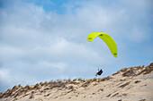 Paraglider pilots in the dunes, Carcans, Atlantic Ocean, France