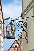 Bird cage in the Finkenherd, historic alley in Quedlinburg, Saxony-Anhalt, Germany
