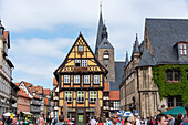 Tourists walk across the market square of the world heritage city of Quedlinburg, Saxony-Anhalt, Germany