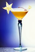 A Champagne Cocktail with Star Fruit & Cherry