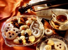 Classic Christmas biscuits, cup of tea, violin & notes