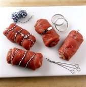 Rolled roulades secured in different ways