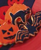Various Halloween biscuits (pumpkins, cat, bat)
