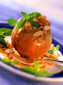 Mela al forno (Baked apple with biscuit stuffing & almonds)