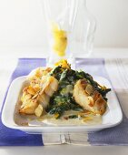 Fried red perch fillet with spinach and flaked almonds