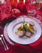 Salmon roll with ricotta filling and lettuce hearts